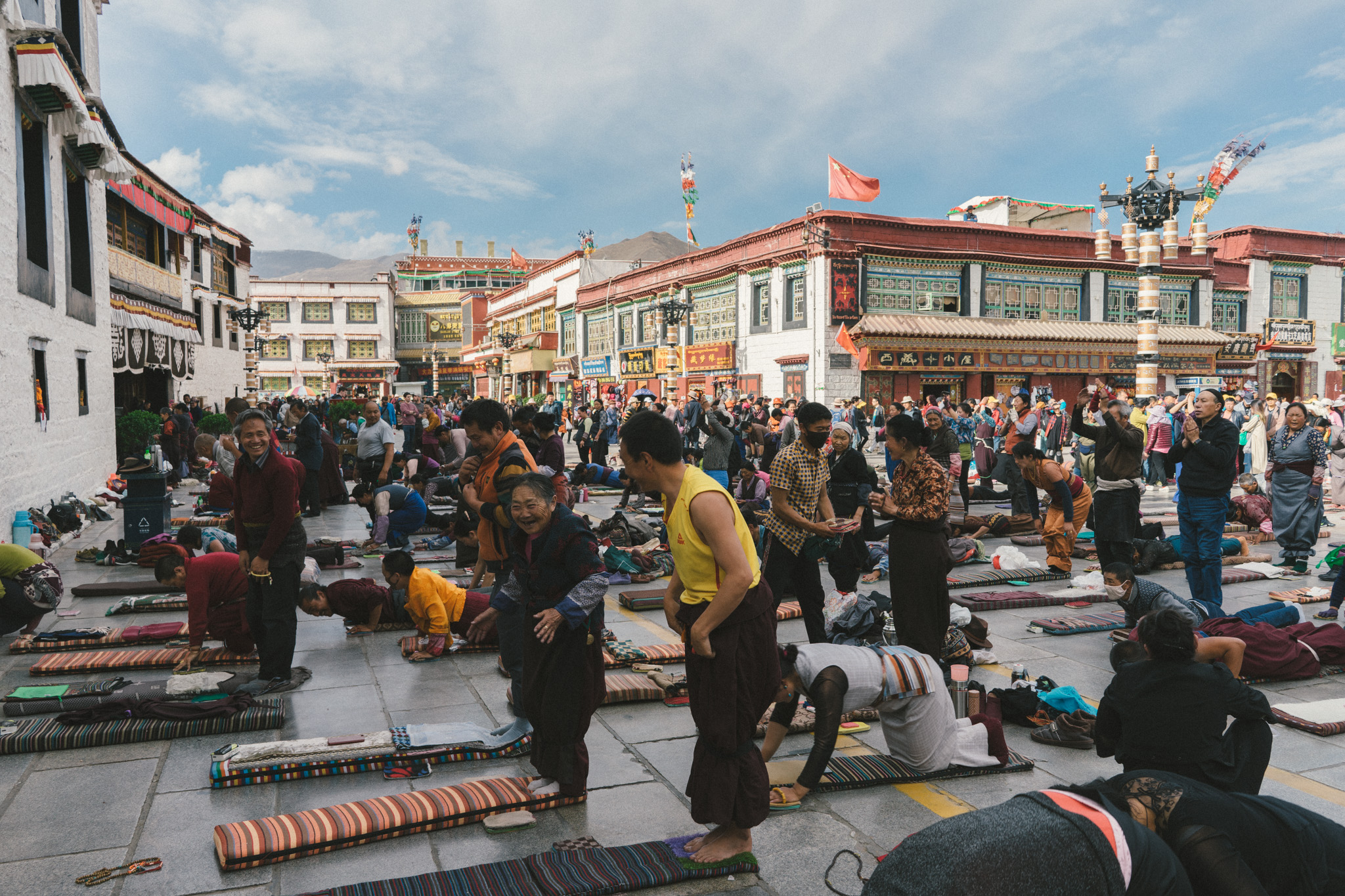 Tibetans prostrating in front of the Jokhang Monastery