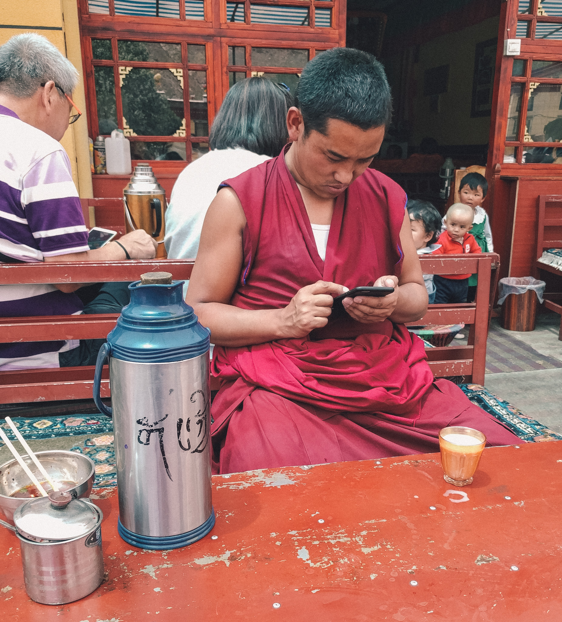 Monk on a cellphone in Tibet