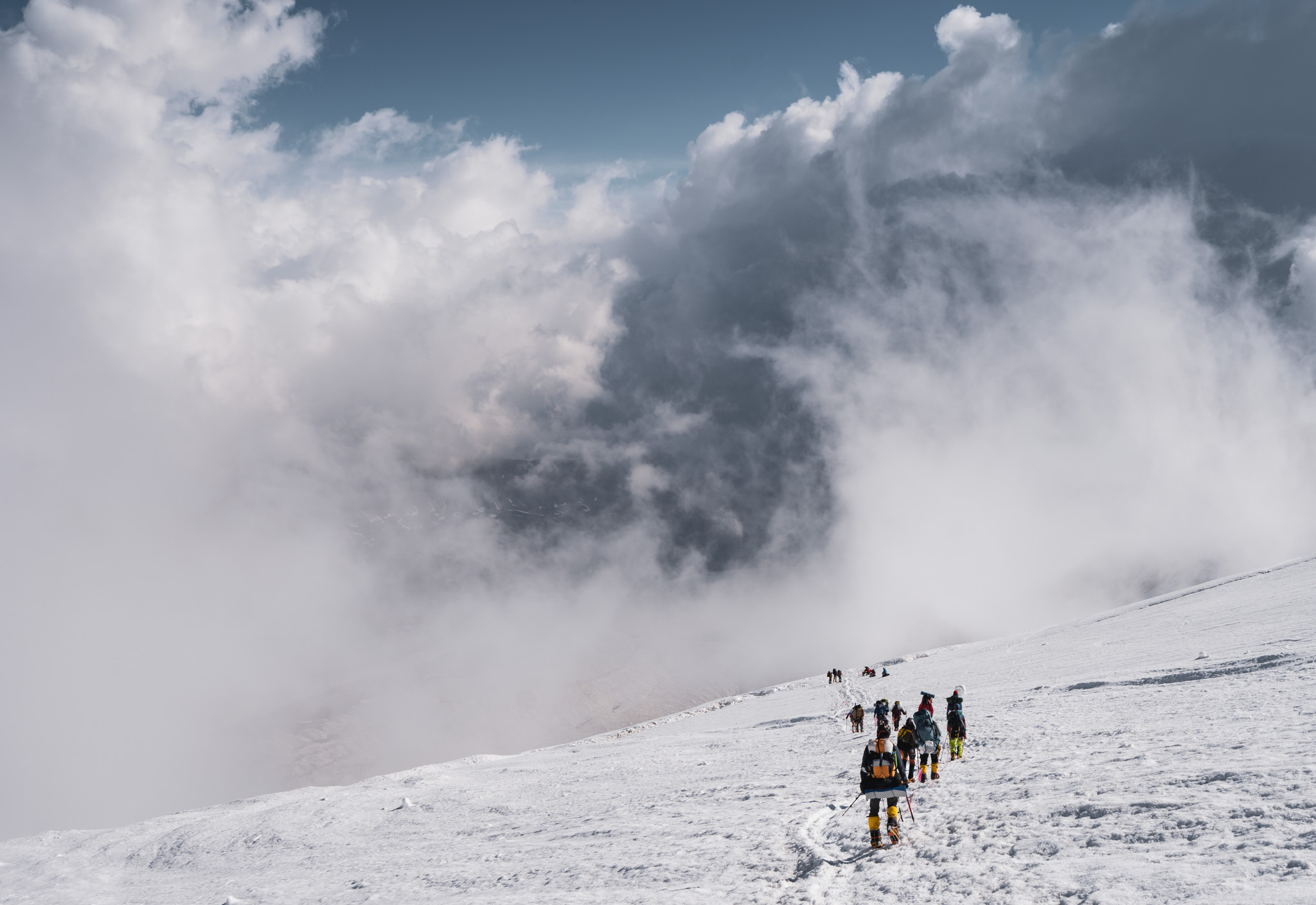 Climbing in the clouds between Camp 1 and Camp 2 on Lenin Peak