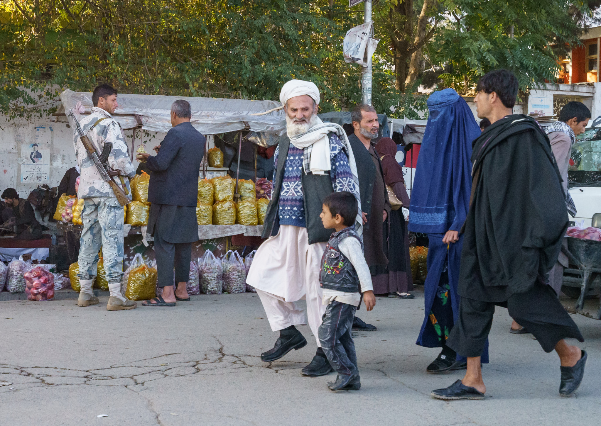 Typical street scene in Afghanistan. Notice the AK-47? Hope you're not afraid of guns!