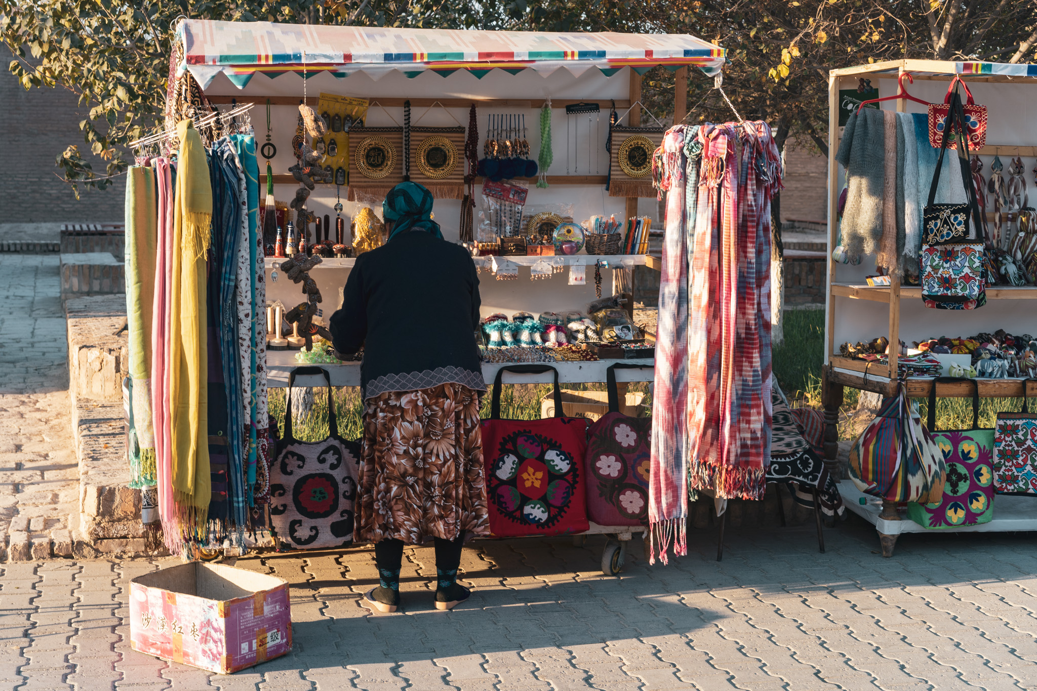 A souvenir seller in Khiva's old town